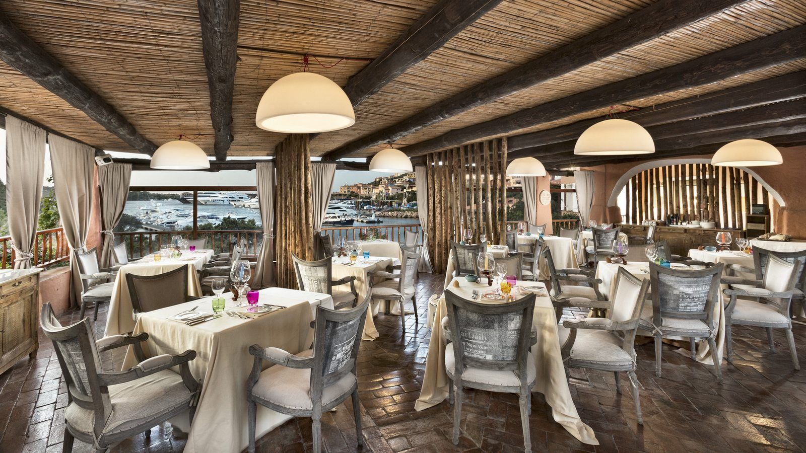 la pergola restaurant view on port and village